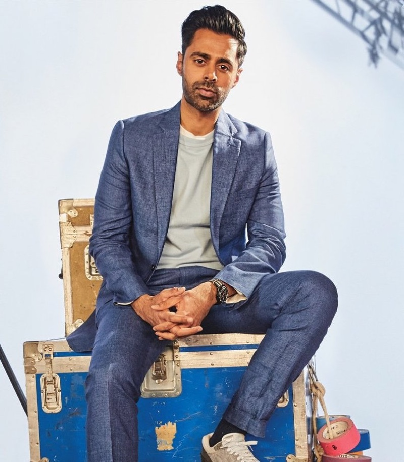 Connecting with Todd Snyder for spring, Hasan Minhaj wears the brand's Italian tropical wool suit and jacket and dress pants with a Todd Snyder + Champion midweight short-sleeve sweatshirt.