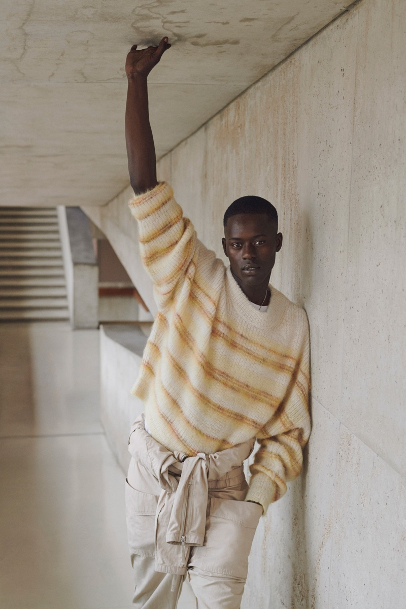 Alpha Dia models a chic neutral-colored look from Isabel Marant's spring-summer 2021 men's collection.