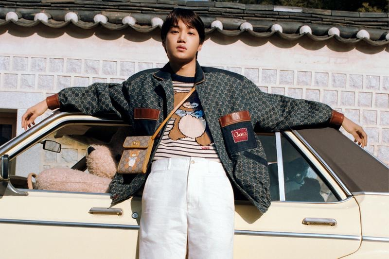 Front and center, Kai sports a striped teddy bear sweater and leather bag from his Gucci capsule collection.