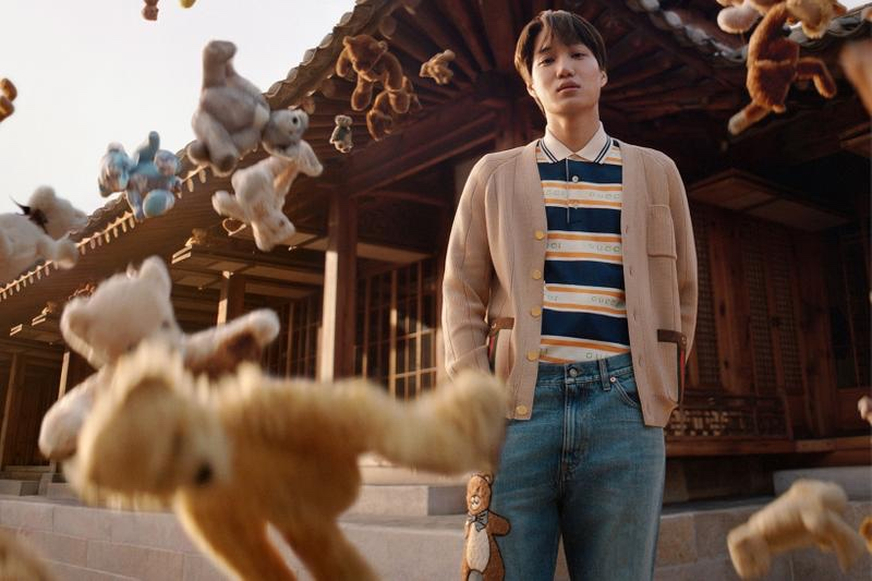 K-pop star Kai rocks teddy bear embroidered jeans from his Gucci capsule collection.