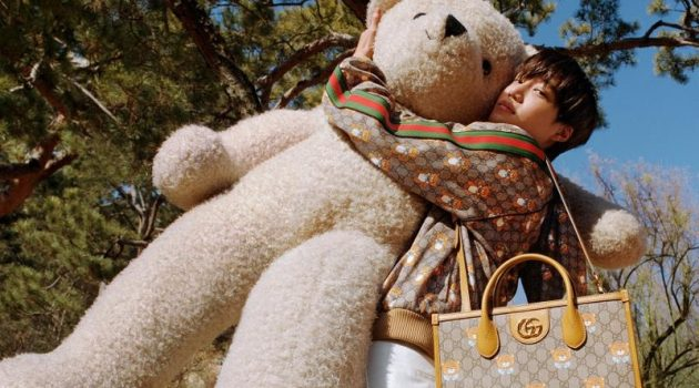 Kai poses with an oversized teddy bear in the campaign for his new Gucci capsule collection.