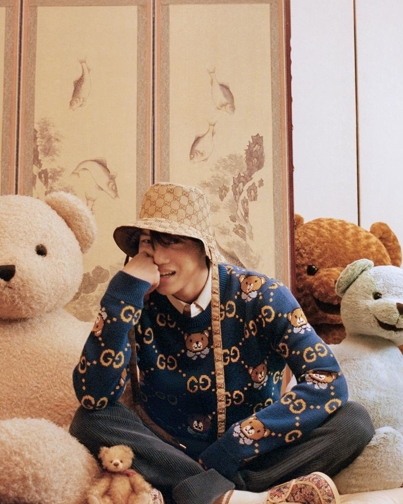 All smiles, Kai wears a teddy bear patterned sweater from his Gucci capsule collection.