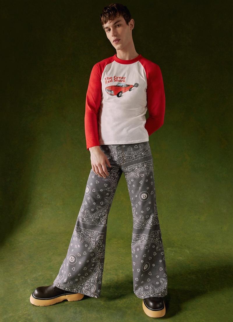 Embracing a retro attitude, Kit Butler dons a Natasha Zinko car-motif t-shirt with wide-leg bandana trousers from Harrods.