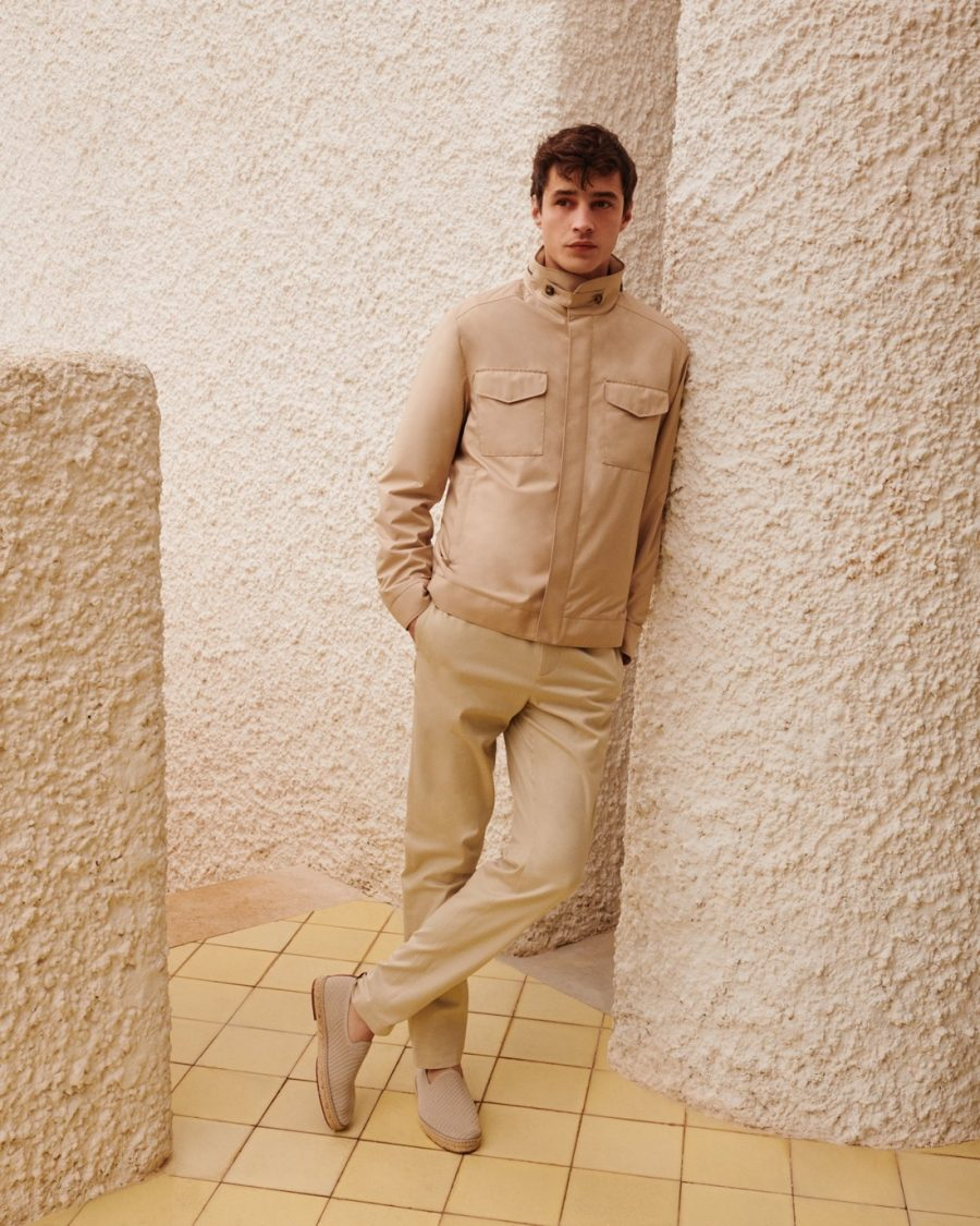 French model Adrien Sahores dons a monochromatic look from Loro Piana's Traveller collection.