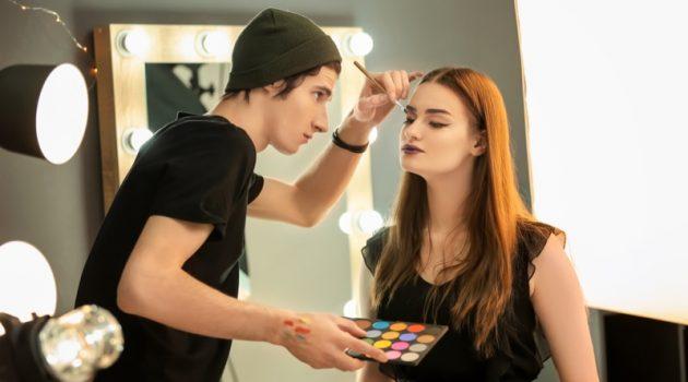 Male Makeup Artist Applying Brush Model Face