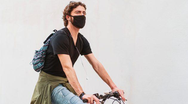 Man Riding Bike Wearing Mask
