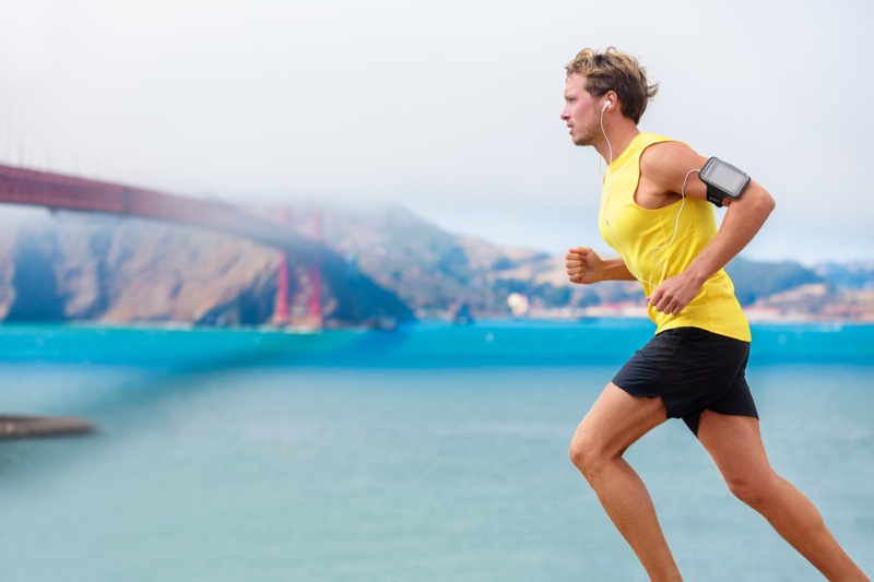 Man Running Yellow Tank Arm Band Black Shorts Activewear