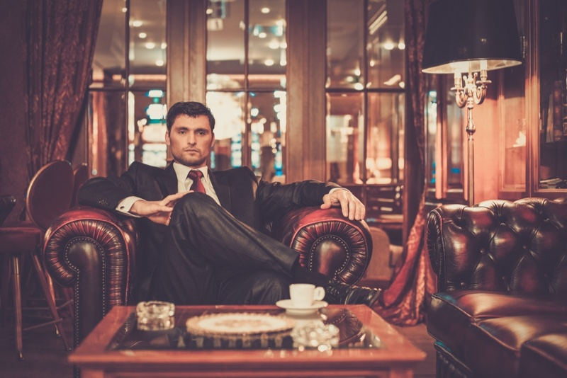Man Well Dressed Suit Sitting Leather Chair