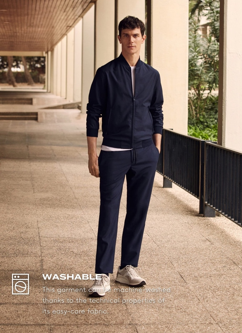 Embracing a navy look from Mango's High-Performance collection, Vincent Lacrocq wears packable collection technical woolen pants.