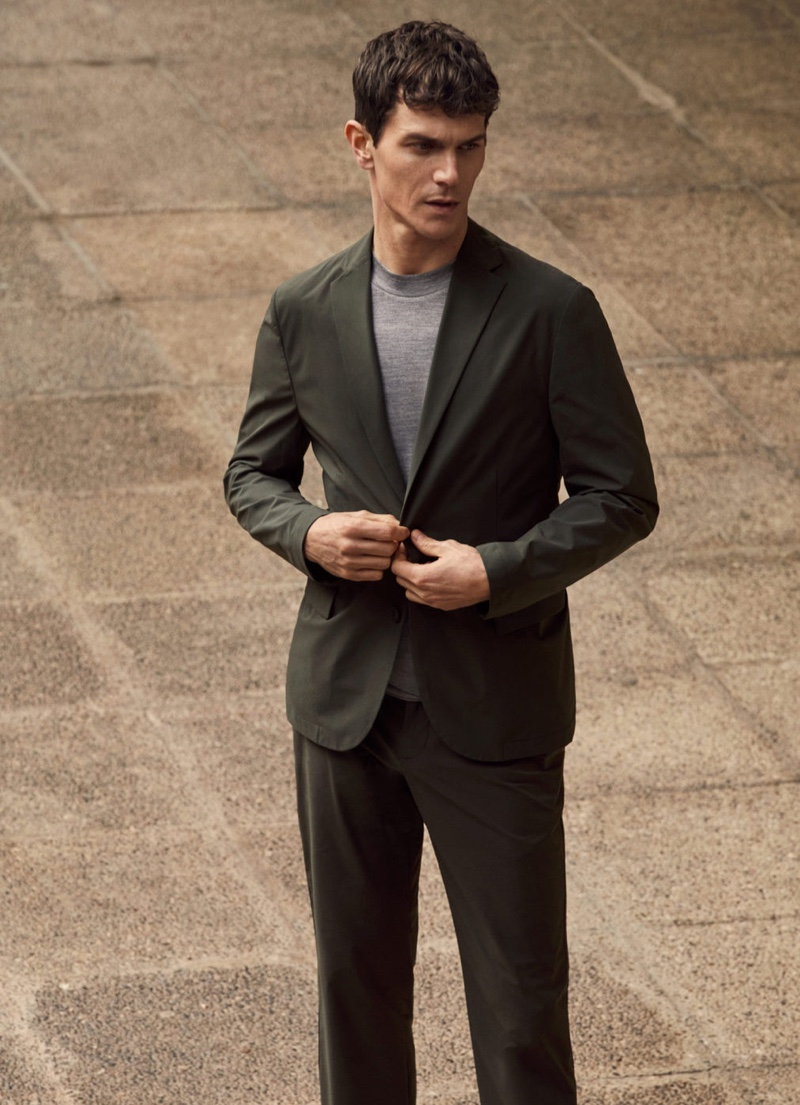 French model Vincent Lacrocq suits up in a packable collection slim-fit blazer and pants from Mango's High-Performance collection.