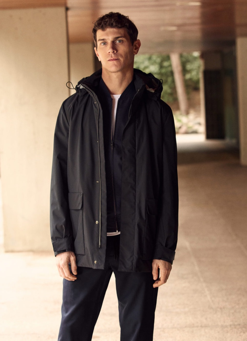 Front and center, Vincent Lacrocq dons a pocket water-repellent trench coat from Mango's High-Performance collection.