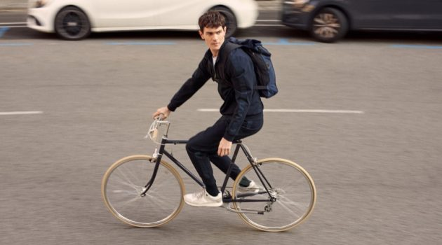 Going for a bike ride, Vincent Lacrocq models pieces from Mango's High-Performance collection.