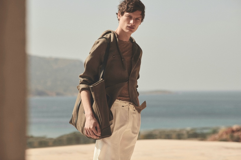 Sporting chic neutrals, Valentin Caron models a 100% linen hooded overshirt from Massimo Dutti's spring 2021 Limited Edition collection.