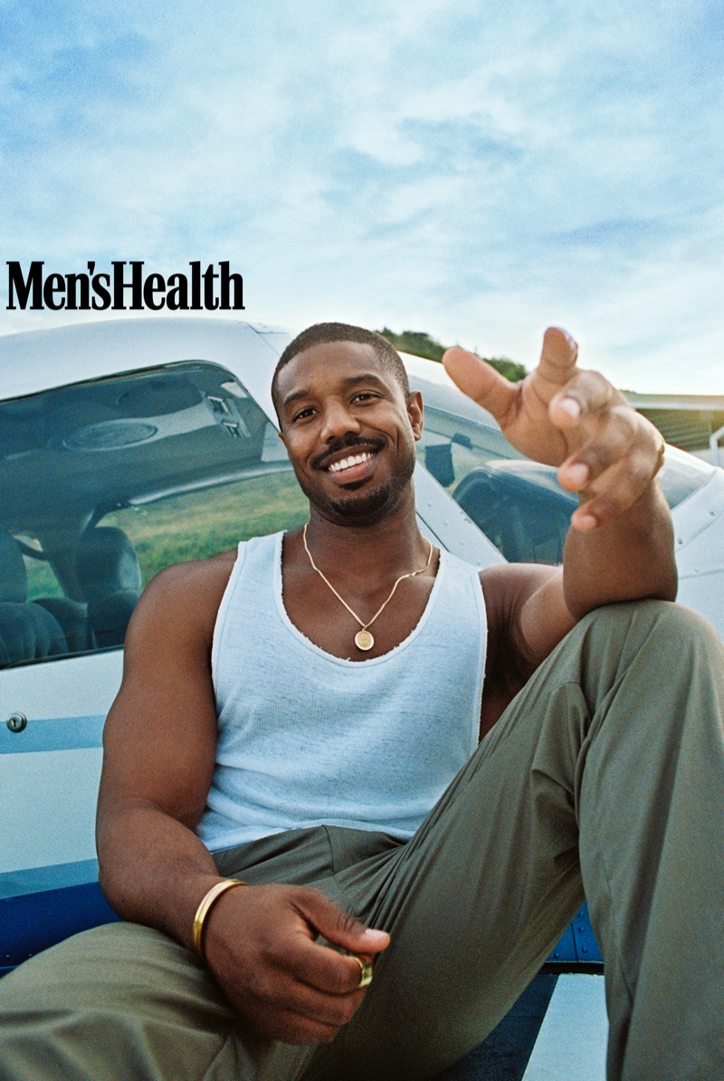 All smiles for Men's Health, Michael B. Jordan wears a vintage tank from Society Archive with Coach pants and a Movado bracelet.