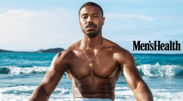 Taking to St. Barts with Men's Health, Michael B. Jordan sports Coach swim shorts with a Movado bracelet.