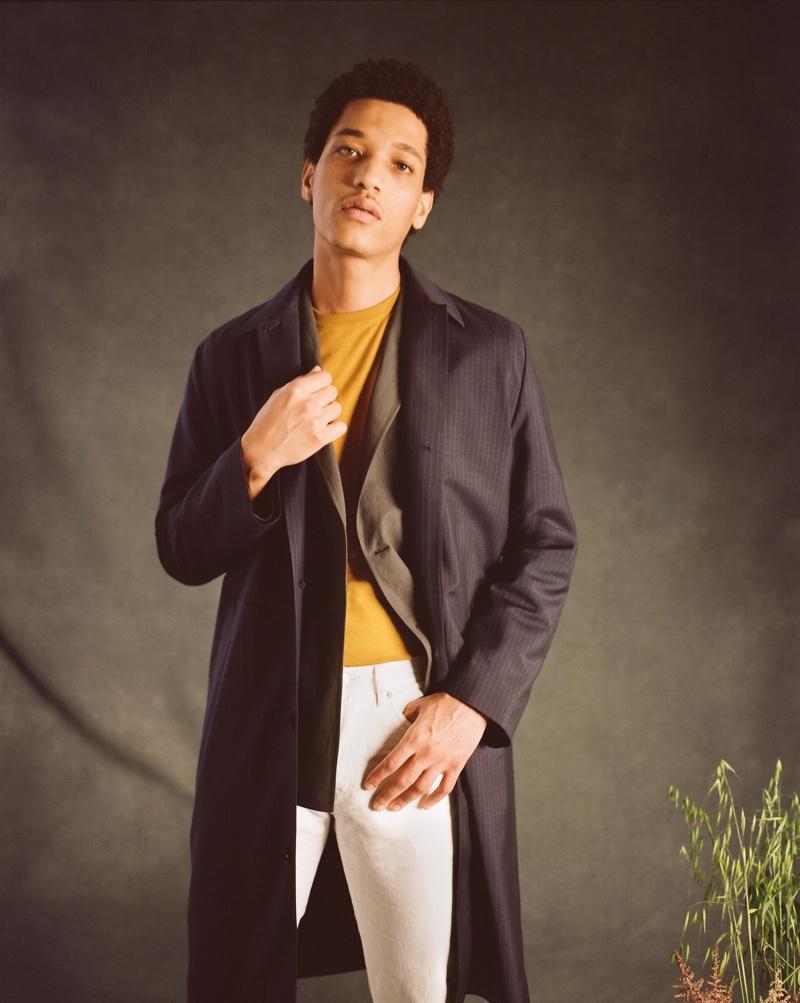 Making a smart statement, Peter Finn models Mr P.'s pinstriped virgin wool, merino wool, and silk-blend car coat.