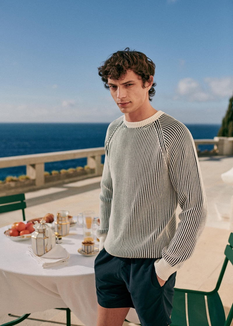 Offering up a beach-worthy look, Andrea Quaranta sports an Octobre sweater with shorts.