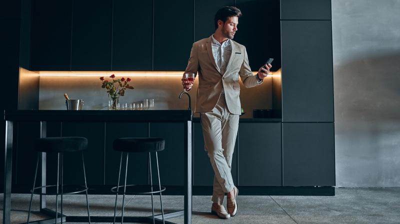 Stylish Man Home Kitchen Suit Holding Glass