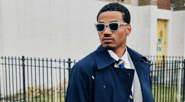 Sporting a dapper look, Tyshawn Jones wears his Harris checkered bone and whirlpool sunglasses, made in collaboration with Warby Parker.