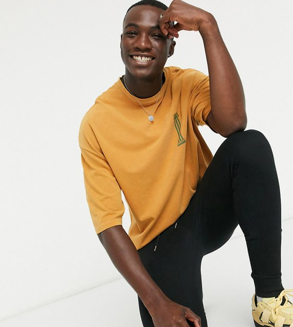 ASOS DESIGN Tall oversized heavyweight t-shirt with small chest historic print in yellow acid wash