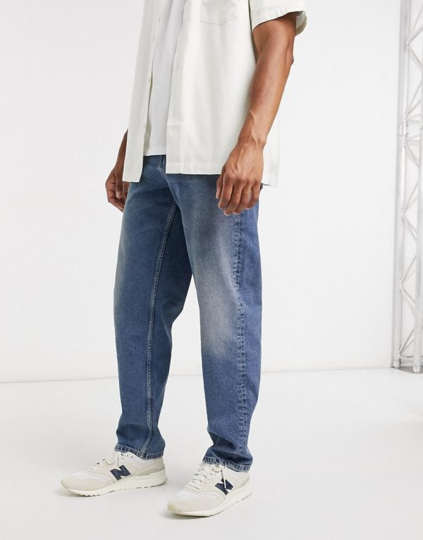 ASOS DESIGN baggy jeans in dirty mid blue wash-Blues