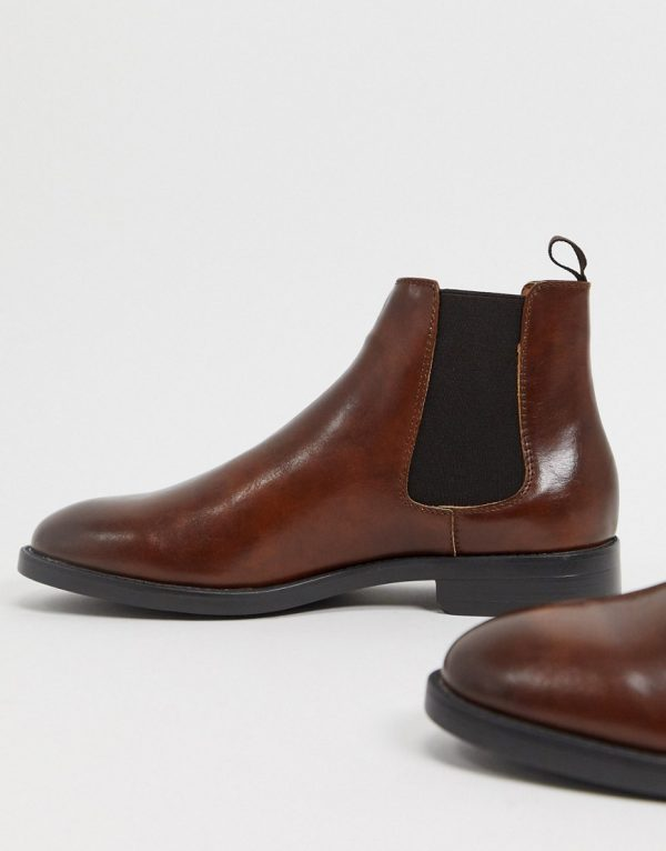 ASOS DESIGN chelsea boots in brown faux leather with black sole