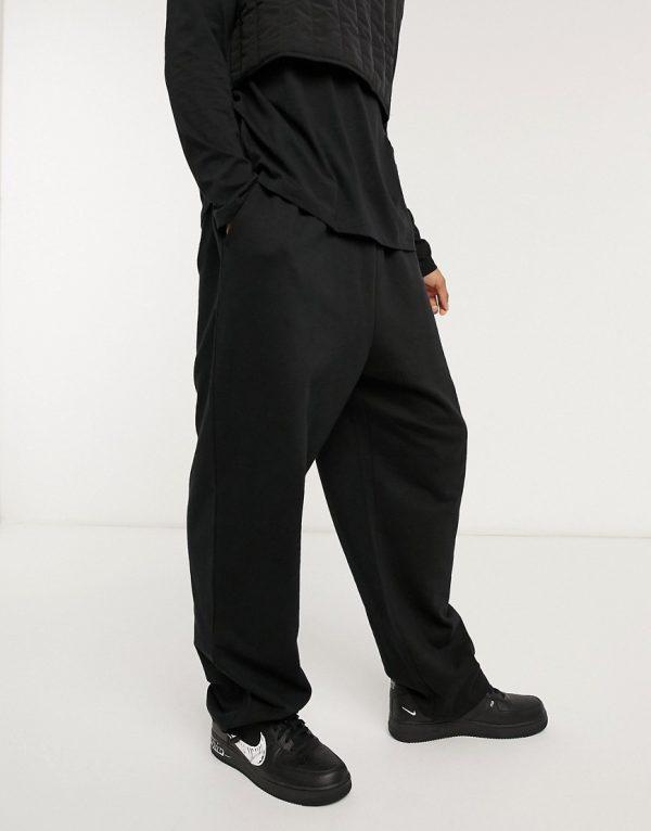 ASOS DESIGN organic super oversized sweatpants in black with toggle hem