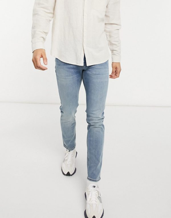 ASOS DESIGN skinny jeans in mid wash-Blues