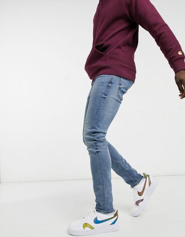 ASOS DESIGN skinny jeans in mid wash blue-Blues