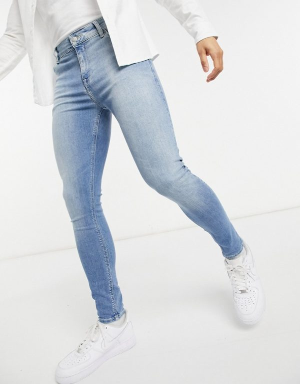 ASOS DESIGN spray on jeans in power stretch denim in light wash-Blue