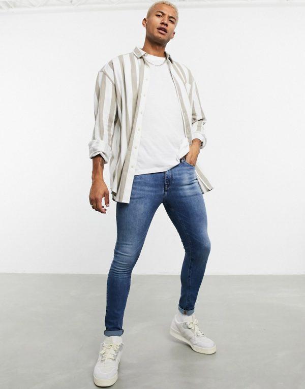 ASOS DESIGN spray on jeans in power stretch denim in mid wash blue-Blues