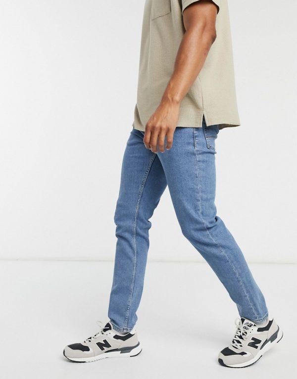ASOS DESIGN stretch slim jeans in flat mid wash blue-Blues