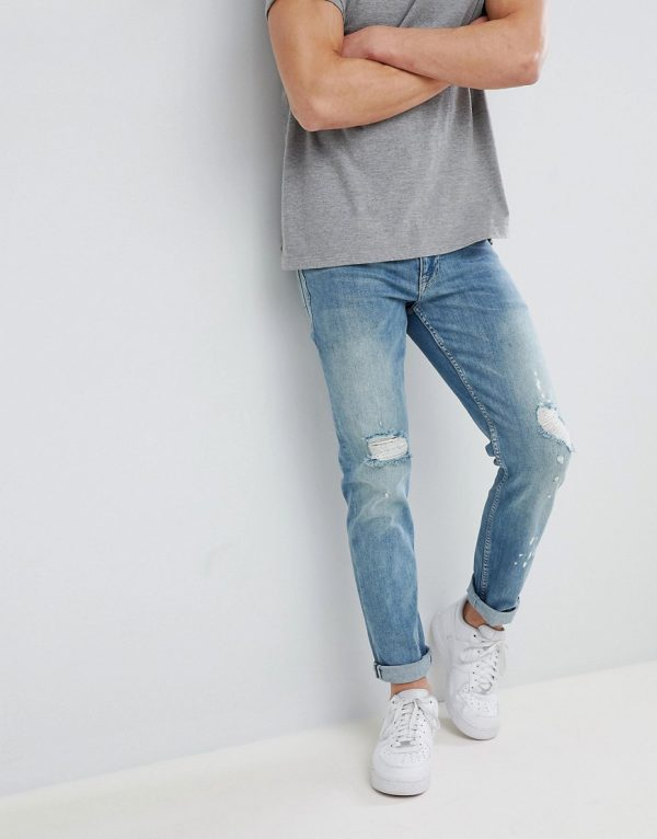 ASOS DESIGN stretch slim jeans in mid wash blue with rips-Blues
