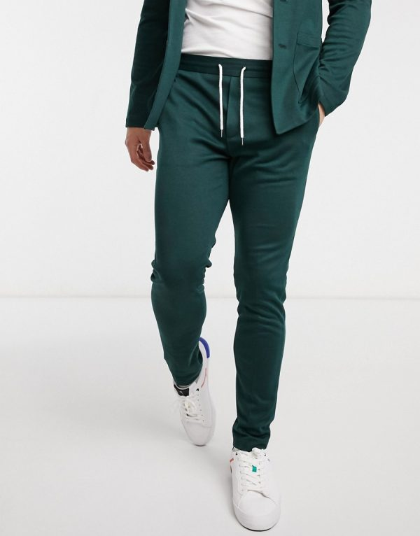 ASOS DESIGN super skinny soft tailored suit pants in jersey in bottle green