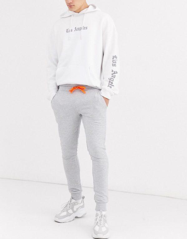 ASOS DESIGN super skinny sweatpants in gray marl with neon orange drawcords