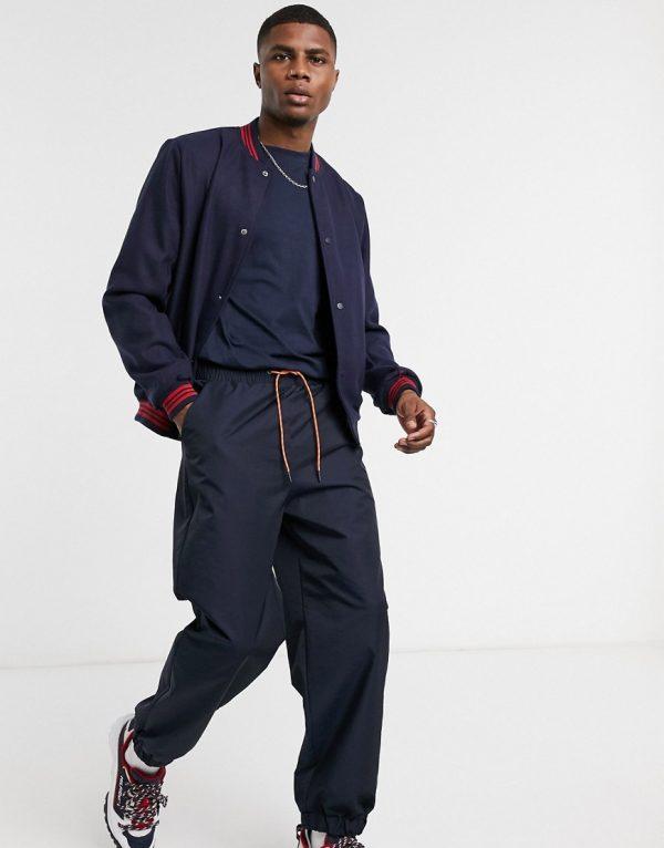 ASOS DESIGN wool blend varsity jacket in navy