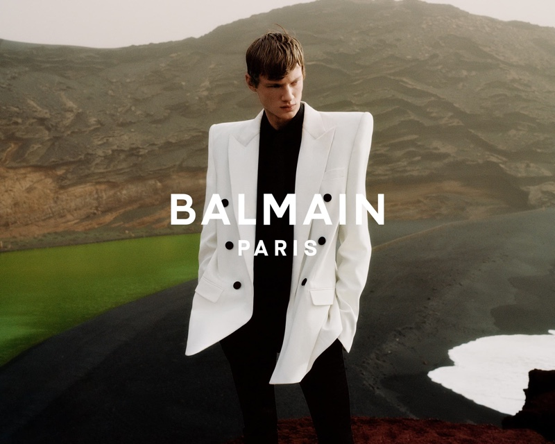 Donning a chic double-breasted blazer in white, Braien Vaiksaar appears in Balmain's spring-summer 2021 men's campaign.