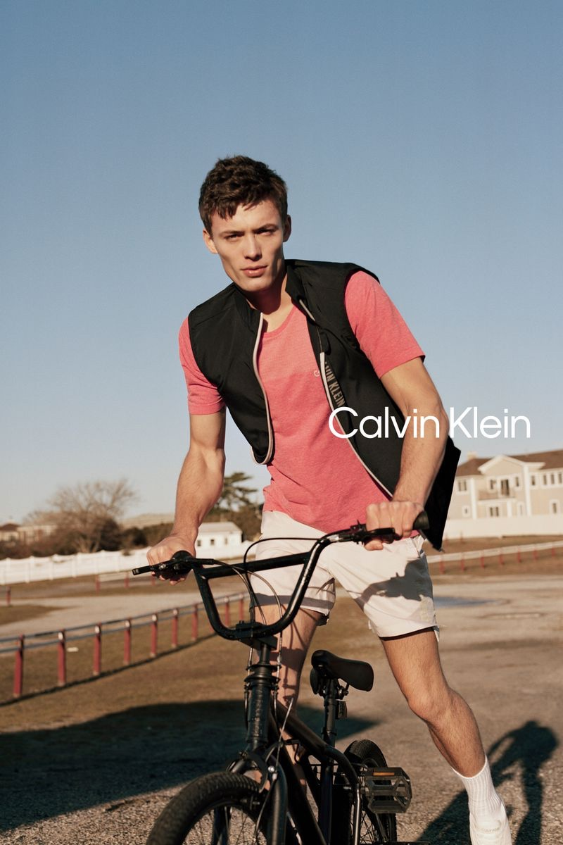 Riding a bike, João Knorr stars in Calvin Klein Performance's spring 2021 campaign.