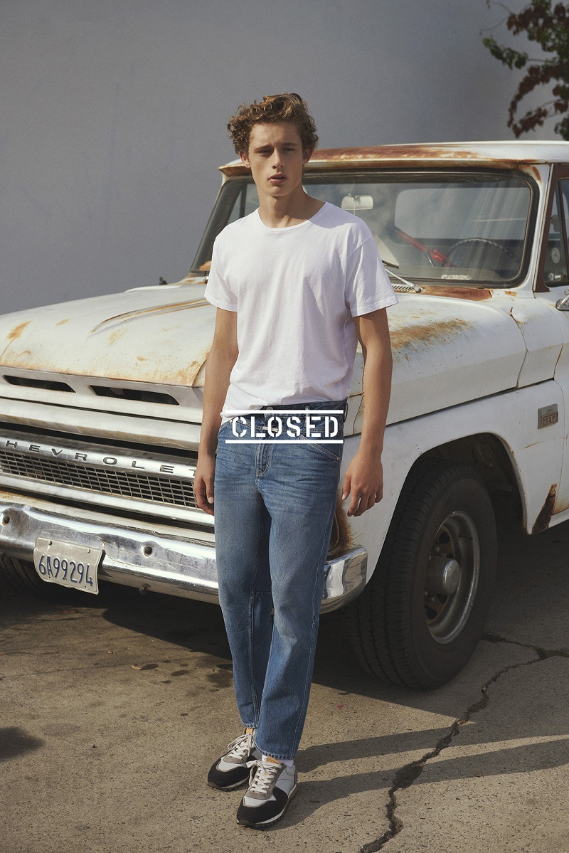 Front and center, Elijah Claxton goes casual in a t-shirt and jeans from Closed.