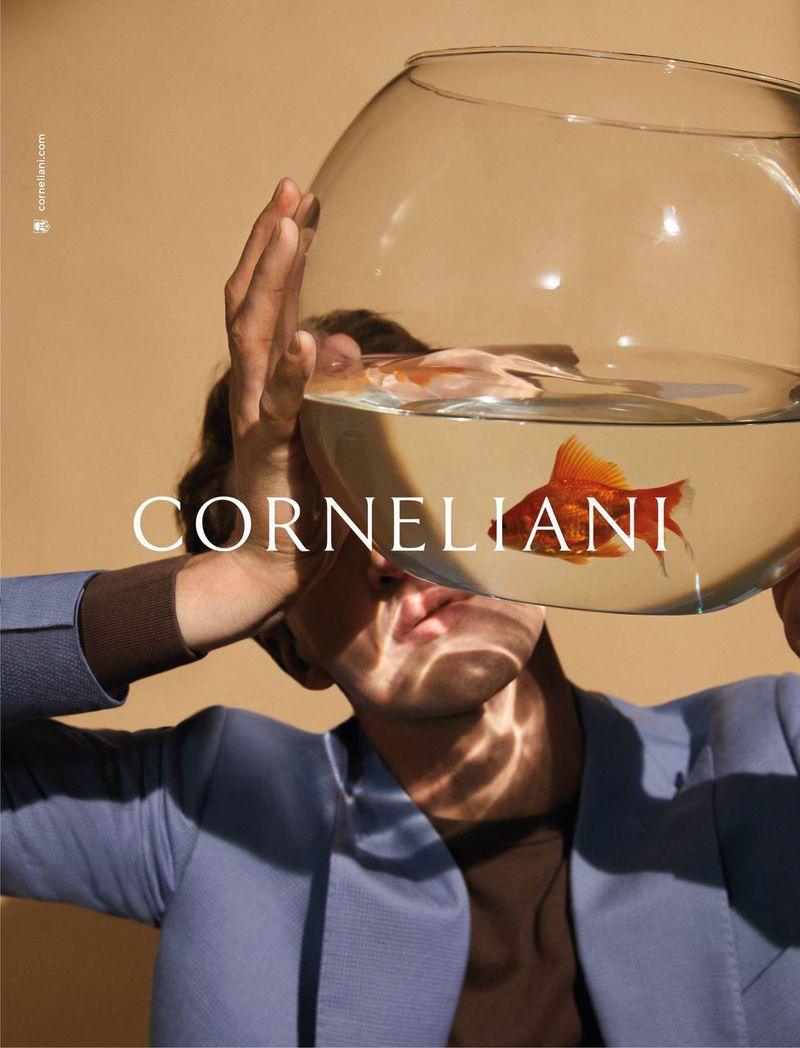 Holding a fishbowl, Anatol Modzelewski appears in Corneliani's spring-summer 2021 campaign.