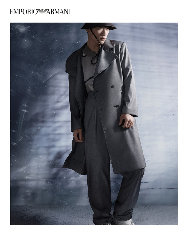 Donning a gray trench, Jackson Yee fronts Emporio Armani's spring-summer 2021 campaign.