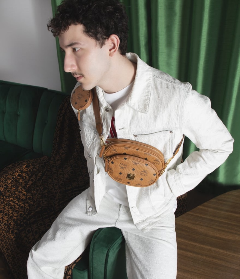 Donning leather accessories from MCM, Frankie Jonas fronts the label's spring 2021 campaign.