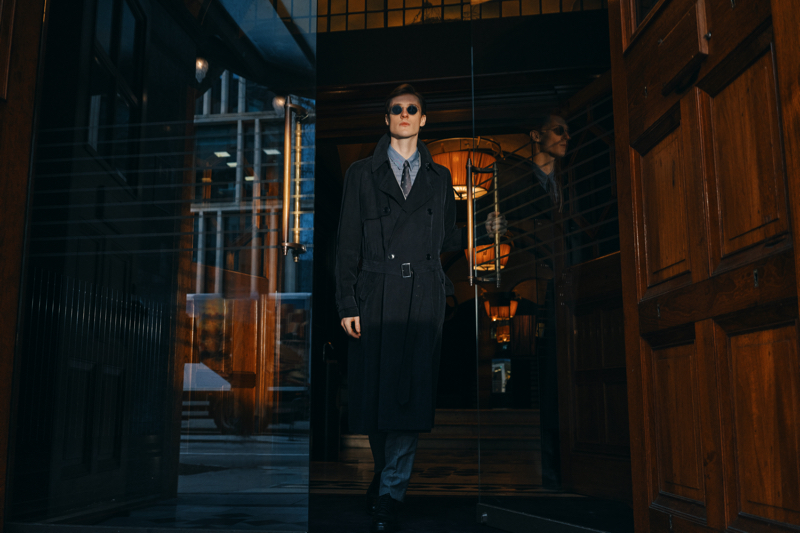 A sleek vision, Tommaso de Benedictis models a Giorgio Armani herringbone-jacquard trench coat with a slim-fit striped cotton and silk-blend shirt and silk-jacquard tie.