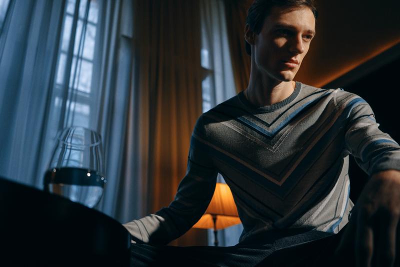 Model Tommaso de Benedictis dons a Giorgio Armani Intarsia wool sweater from Mr Porter.