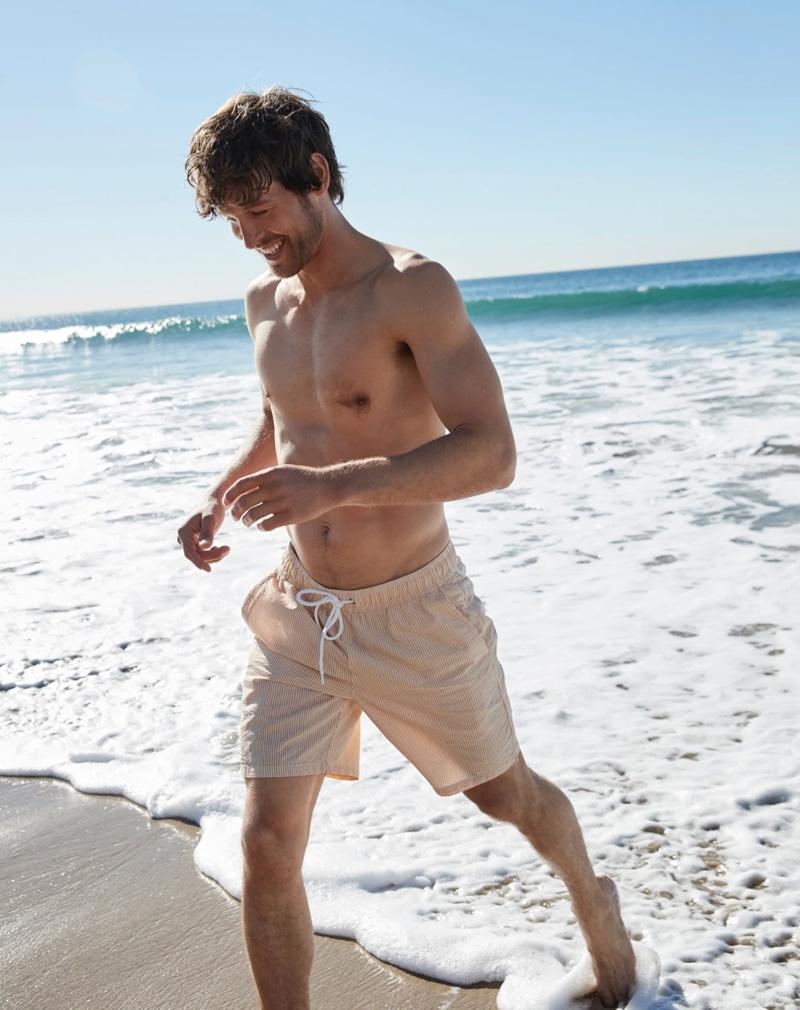 "Enjoying a day at the beach, Josh Upshaw wears J.Crew's 6"" swim trunk in pink seersucker."