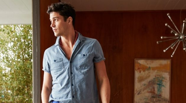 Miles McMillan wears a short-sleeve shirt with pants from J.Crew.