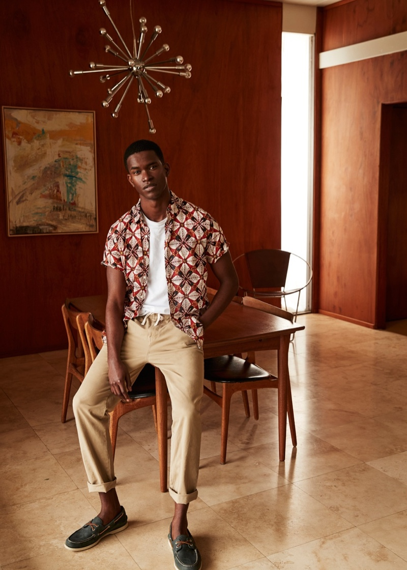 Front and center, Salomon Diaz dons a printed short-sleeve shirt with drawstring pants from J.Crew.