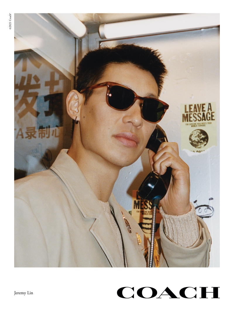 Making a phone call, Jeremy Lin appears in Coach's spring 2021 eyewear campaign.