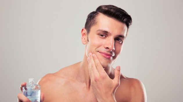 Male Touching Face Aftershave Grooming