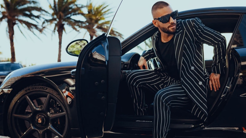 Stepping out of a luxury car, Maluma dons a pinstripe suit from his Balmain capsule collection.